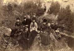 Group of people seated on a rock above the Elora Gorge Ontario 1890
