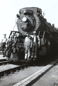 Picture of railway workers standing in front of a locamotive
